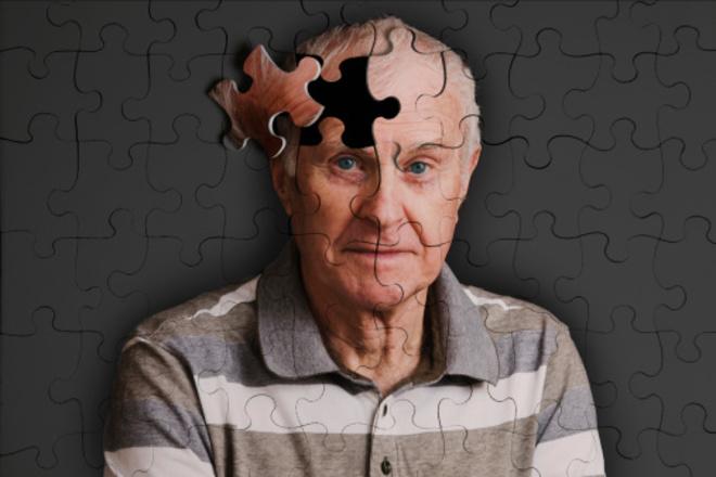 Jigsaw puzzle, of senior man, falling apart
